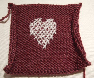reverse stocking stitch square with heart